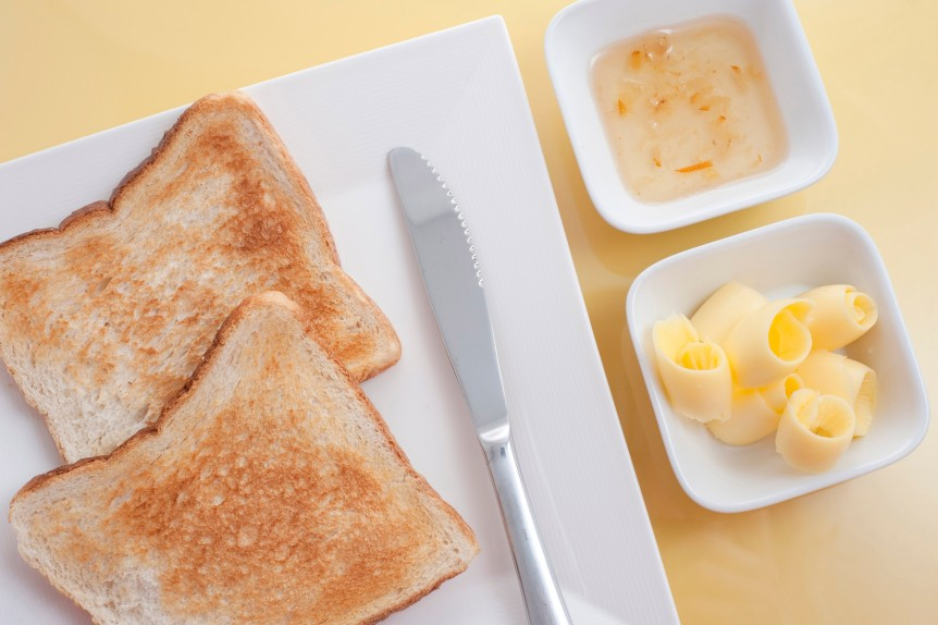 Serving of toast with butter and marmalade